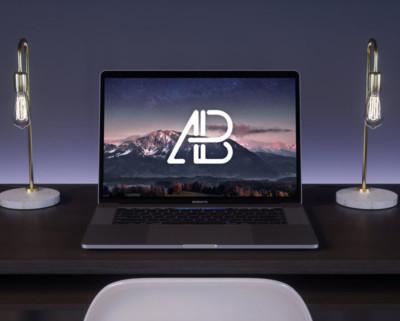 free-macbook-pro-on-desk-night-mockup-1000x750M